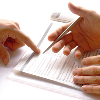 Vagueness and Ambiguity in Contracts